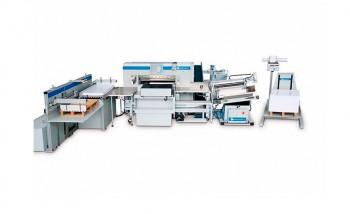 Резальный комплекс, состоящий из одноножевой резальной машины Wohlenberg и периферийного оборудования Baumann