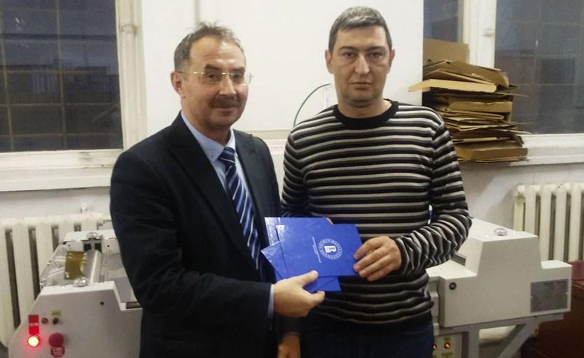 Директор типографии ВШЭ Марсель  Шарифуллин и директор Русской Индустриальной Группы Сергей Гулый